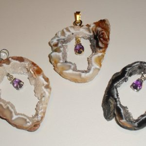 Amethyst facetted stone in Oco pendant All Crystal Jewelry Amethyst facetted stone in Oco p